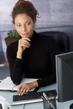 Young businesswoman working on computer Stock Photo