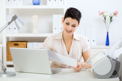 Young businesswoman working at home Stock Image