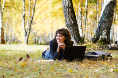Happy young businesswoman using laptop outdoor Stock Photos