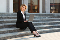 Young businesswoman working on laptop Royalty Free Stock Images