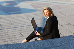 Young businesswoman working on laptop Stock Image