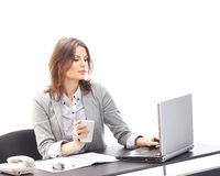 A young businesswoman working on the laptop Stock Photos