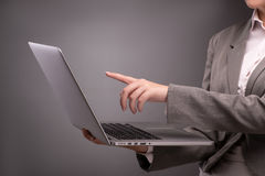 The young businesswoman working with laptop in business concept Royalty Free Stock Image