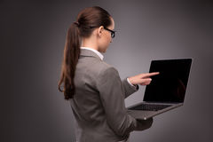 The young businesswoman working with laptop in business concept Royalty Free Stock Photo
