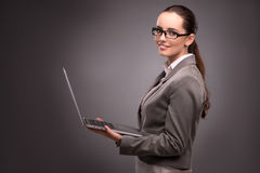 The young businesswoman working with laptop in business concept Stock Photos