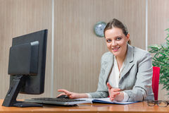 The young businesswoman working with laptop in business concept Royalty Free Stock Photography