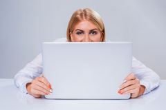 Young businesswoman working at laptop computer. Royalty Free Stock Image