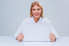 Young businesswoman working at laptop computer. Stock Image