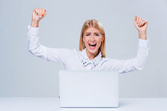 Young businesswoman working at laptop computer. Royalty Free Stock Photography