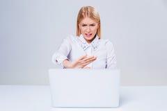 Young businesswoman working at laptop computer. Stock Photos