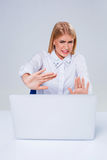 Young businesswoman working at laptop computer. Royalty Free Stock Photos