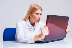 Young businesswoman working at laptop computer. Stock Photo
