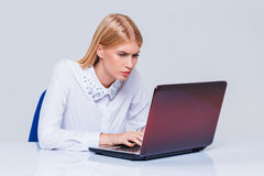 Young businesswoman working at laptop computer. Stock Photography