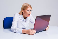 Young businesswoman working at laptop computer. Royalty Free Stock Images