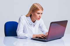 Young businesswoman working at laptop computer. Stock Photos