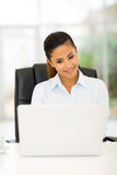 Young businesswoman working on laptop Royalty Free Stock Image