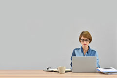 Young businesswoman working on laptop Stock Photography