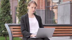 Young Businesswoman working on Laptop, Sitting Outdoor on Bench. 4k high quality, 4k high quality stock video