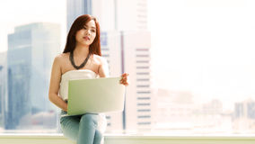 Young businesswoman working with laptop Stock Photos