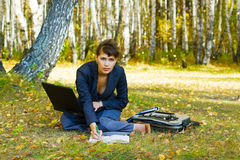 Young businesswoman working on nature. Royalty Free Stock Photography