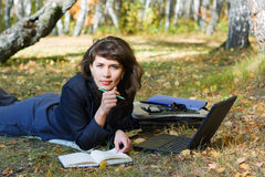 Young businesswoman working on nature. Royalty Free Stock Photo