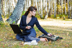 Young businesswoman working on nature. Stock Photos