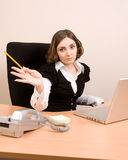 Young businesswoman working at the office Stock Photos