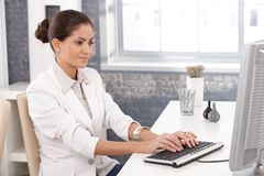 Young businesswoman working in office Stock Photo