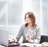 A young businesswoman working in the office Stock Images