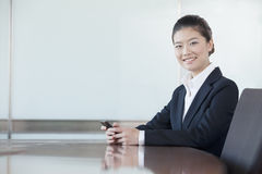 Young businesswoman working in office Royalty Free Stock Image