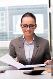 The young businesswoman working in the office. Young businesswoman working in the office Royalty Free Stock Photography