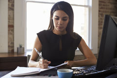 Young Businesswoman Working In Office Royalty Free Stock Photos