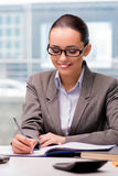 The young businesswoman working in the office. Young businesswoman working in the office Stock Photo