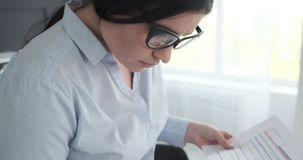 Young businesswoman working at office. Businesswoman doing paperwork at office stock video