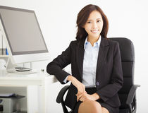 Young businesswoman working in the office Stock Photography