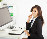 Young businesswoman working in the office. Happy young businesswoman working in the office Royalty Free Stock Photos