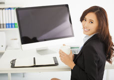 Young businesswoman working in the office. Happy young businesswoman working in the office Stock Photography
