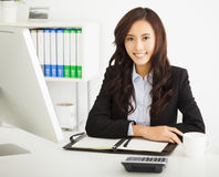 Young businesswoman working in the office. Happy young businesswoman working in the office Stock Image