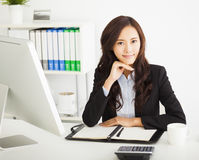 Young businesswoman working in the office. Happy young businesswoman working in the office Royalty Free Stock Photo