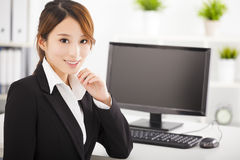 young businesswoman working in the office Stock Images
