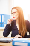 Young businesswoman working in office with papers Royalty Free Stock Photography