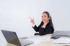 Young businesswoman working in office pointing something. The young businesswoman working in office pointing something Royalty Free Stock Photos