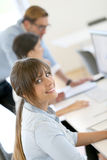 Young businesswoman working in office. Portrait of young businesswoman working in office Royalty Free Stock Photography
