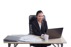 Young businesswoman working in office, typing, using computer. Concentrated woman searching information online Royalty Free Stock Images