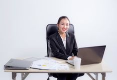 Young businesswoman working in office, typing, using computer. Woman searching information online Royalty Free Stock Photography