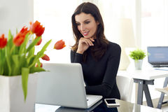 Young businesswoman working online Stock Image