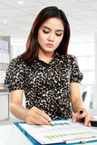 Young businesswoman working with papers Royalty Free Stock Photo