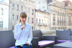 Young businesswoman working in a restaurant terrace. Stock Images
