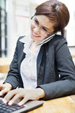 Young businesswoman working at restaurent Royalty Free Stock Photography