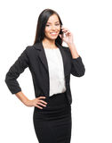 A young businesswoman working on a smartphone Royalty Free Stock Image